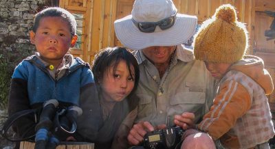 Childrens are gatthering with treker during the Rupina La Pass Tsum valley trip