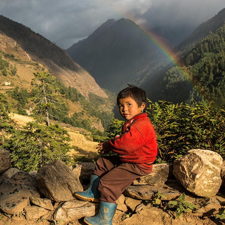 Boy in Tsum valley  and Rainbow backround of him