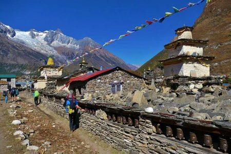 Beautiful mane wall on top with pray falgs and Mt. Manaslu galcier in Samagaun.